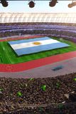 People hold Argentina flag in stadium arena. field 3d photorealistic render. Illustration royalty free illustration
