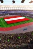 People hold Austria flag in stadium arena. field 3d photorealistic render. Illustration royalty free illustration