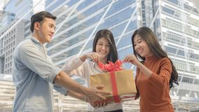 People hold box of gift with red ribbon. The people hold box of gift with red ribbon Stock Images