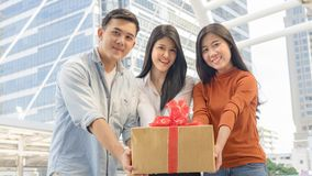 People hold box of gift with red ribbon. The people hold box of gift with red ribbon Stock Photography