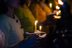 Free People Hold Candles Light At Night Stock Photography - 122679232
