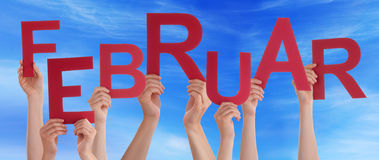 People Hold German Februar Means February Blue Sky. Many Caucasian People And Hands Holding Red Letters Or Characters Building The German Word Februar Which Royalty Free Stock Images
