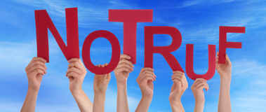 People Hold German Notruf Means Emergency Blue Sky Stock Image