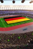People hold Germany flag in stadium arena. field 3d photorealistic render. Illustration royalty free illustration