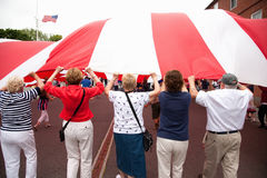 People hold giant US Flag Royalty Free Stock Photography