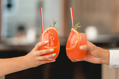 People hold in hands glasses with orange cocktail. wedding party. Royalty Free Stock Photos