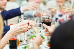People hold in hands glasses with white and  red wine. People hold in hands glasses with white and red wine Royalty Free Stock Photography