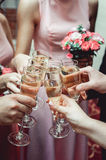 People hold in hands glasses with white wine. wedding party. Royalty Free Stock Photo