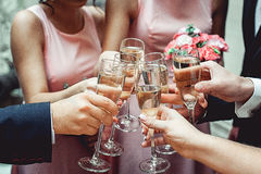 People hold in hands glasses with white wine. wedding party. Stock Photography