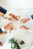 People hold in hands glasses with white wine. wedding party. Royalty Free Stock Images