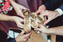 People hold in hands glasses with white wine. wedding party. Stock Image
