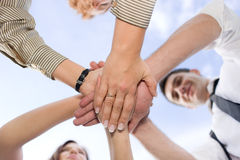People hold hands together Stock Photo