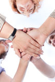 People hold hands together. Office workers hold hands together across the sky royalty free stock image