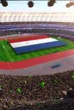 People hold Netherlands flag in stadium arena. field 3d photorealistic render. Illustration royalty free illustration
