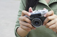 People Hold An Old Camera. For some hobbyist, old camera have their uniqueness and memorable story Royalty Free Stock Photography