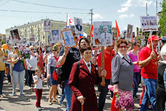 People hold portraits of their relatives in the action `Immortal regiment` on Victory day in Volgograd Royalty Free Stock Images