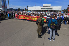 People hold red banner of Immortal regiment and portraits of their relatives on 9 May, 2016 in Ulyanovsk, Russia royalty free stock photo