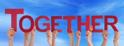 People Hold Red Straight Word Together Blue Sky Stock Photography