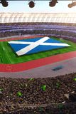 People hold Scotland flag in stadium arena. field 3d photorealistic render vector illustration
