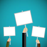 People hold signs in their hands. Pickets and demonstrations.  Royalty Free Stock Image
