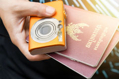 People hold Thailand passports and digital camera in hand,. Travel and tourism concept stock images