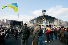 People hold Ukrainian flag on the square Stock Photography