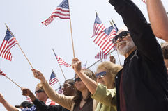 People Holding American Flag During A Rally Royalty Free Stock Photo