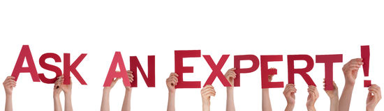 People Holding Ask An Expert. Many People Holding the Red Words Ask An Expert, Isolated Stock Image