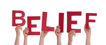 People Holding Belief. Many People Holding the Red Word Belief, Isolated Stock Photo