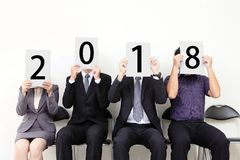 People holding 2018 billboard stock image