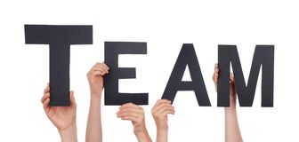 People Holding a Black Team Stock Photos