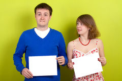People holding a blank paper. On green background stock photography