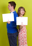 People holding a blank paper. On green background royalty free stock photo