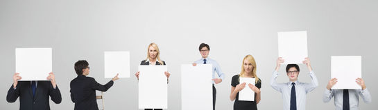People holding blank poster Stock Photos