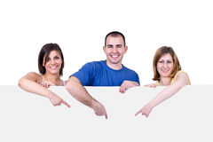 People holding a blank white card Royalty Free Stock Image