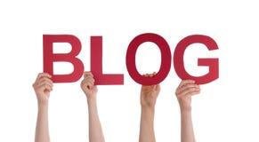 People Holding Blog Stock Photo