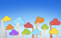 People Holding Colorful Cloud Symbols Royalty Free Stock Image
