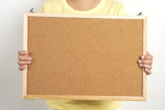 People holding the cork board. People holding a cork board, leave your messages or inform on the cork board Stock Image