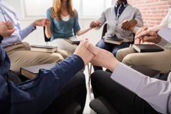 People Holding Each Others Hand Praying Together. Close-up Of People Holding Each Others Hand Praying Together stock photography