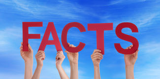 People Holding Facts in the Sky Stock Photos
