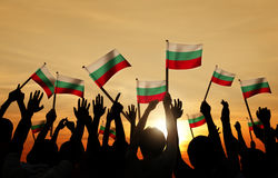 People Holding Flag of Bulgaria in Back Lit Stock Photography