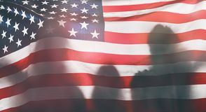 People holding the Flag of the USA stock images