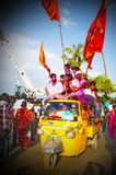 people holding flags on the dayof Ganesh Nimajjan Royalty Free Stock Photos