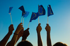 People holding flags of the European Union. Stock Images