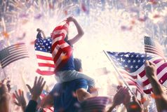 People holding the Flags of the USA. Royalty Free Stock Photography