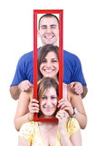 People holding frame Stock Photo