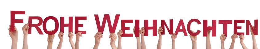 People Holding Frohe Weihnachten. Many People Holding the German Words Frohe Weihnachten Which Means Merry Christmas, on White royalty free stock photography