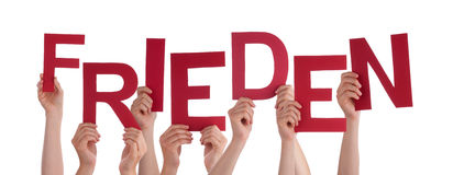 People Holding German Word Frieden Means Peace Stock Images