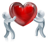 People holding giant heart Royalty Free Stock Image
