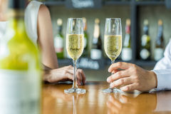 People holding glasses of champagne making a toast Stock Images